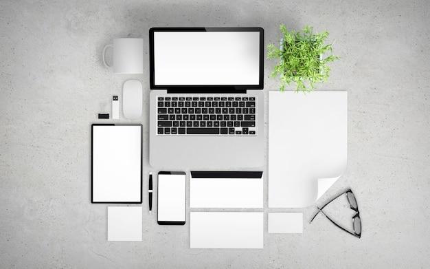 Concrete desktop met kantoorspullen