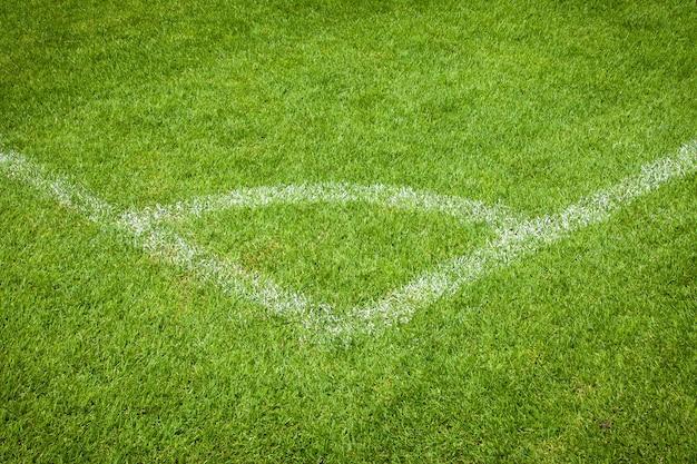 Conner van voetbalveld met groen gras