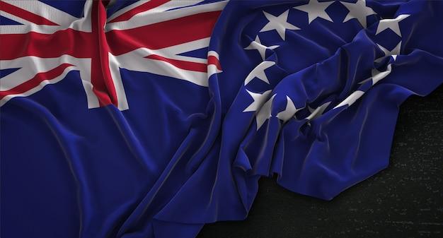 Cook islands flag gerimpelde op donkere achtergrond 3d render
