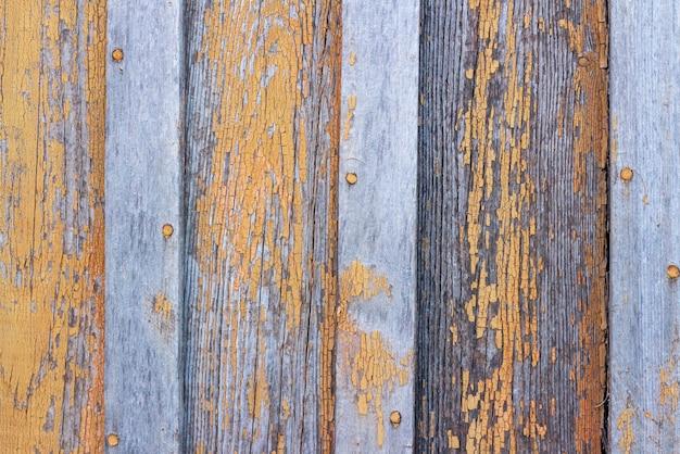 Copyspace achtergrond textuur houten planken met afbladderende verf oranje