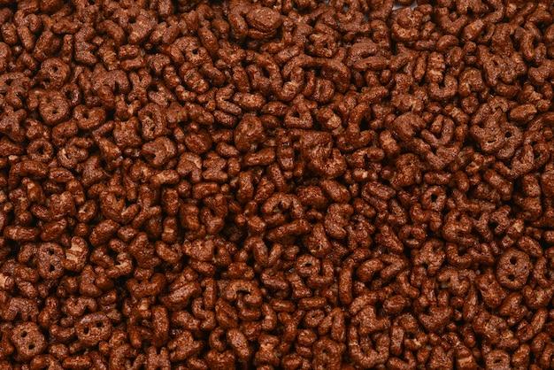 Cornflakes achtergrond en textuur. bovenaanzicht. cornflake cornflakesdoos voor het ochtendontbijt.
