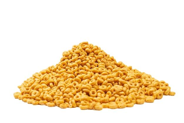 Cornflakes achtergrond en textuur. bovenaanzicht. honing ringen cornflakes doos voor het ontbijt in de ochtend.