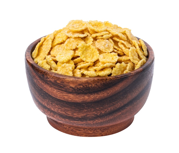 Cornflakes in houten die kom op wit wordt geïsoleerd