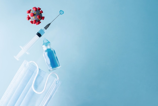Coronavirus-model, spuit met vaccin, fles, masker, covid-19-vaccinconcept