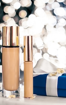 Cosmetische branding kerst glitter en girly blog concept vakantie make-up foundation basis concealer...