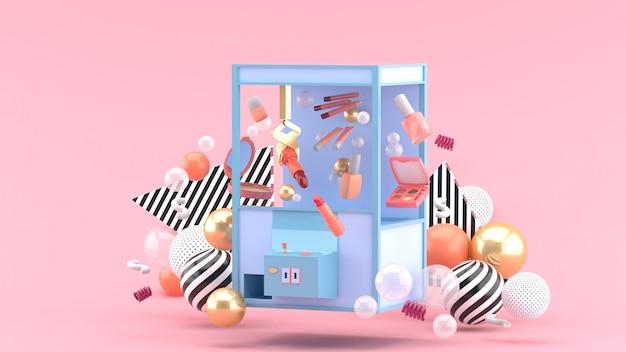 Cosmetische vanger machine temidden van kleurrijke ballen op een roze ruimte
