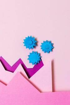 Covid-concept met bovenaanzicht van papieren vormen