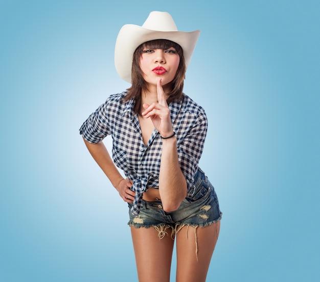 Cowgirl met een index omhoog
