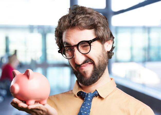 Crazy man met piggy bank.funny expressie