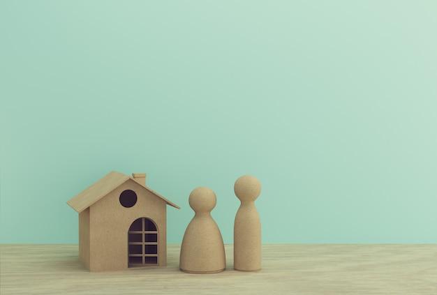 Creatief idee van huis modeldocument en familie op houten lijst. onroerend goed investeringen onroerend goed en huis hypotheek financieel.