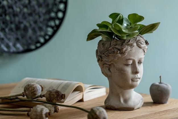 Creatieve compositie van stijlvol scandinavisch interieur met houten consola, planten in design potten en accessoires. eucalyptus muren. details. herfst vibes.