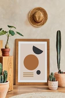 Creatieve compositie van stijlvol woonkamerinterieur met mock-up posterframe, houten kubussen, cactussen en persoonlijke accessoires. plant liefde en natuur concept. sjabloon.