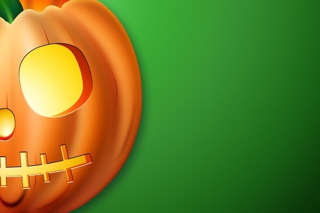 Creatieve halloween-achtergrond. pompoen op een groene achtergrond.