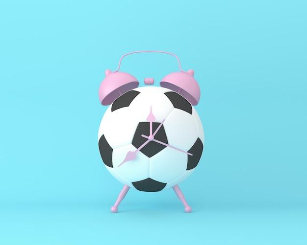 Creatieve idee voetbal voetbalklok op pastel blauwe achtergrond