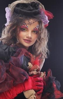 Creatieve make-up. fantasie jurk.