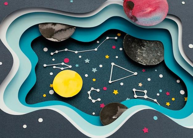 Creatieve opstelling van papieren planeten