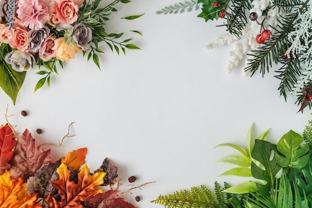 Creatieve seizoenslay-out van kleurrijke zomer-, lente-, herfst- en winterbladeren en bloemen. natuur mockup. seizoensgebonden concept. plat leggen