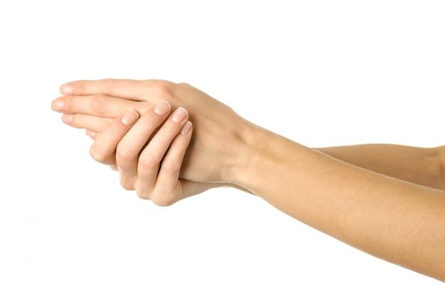Crème aanbrengen, masseren, handen wassen. vrouwenhand gesturing geïsoleerd op wit