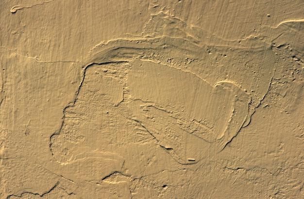 Crème betonnen wand voor interieurs, kunstbehang of artistieke textuur achtergrond