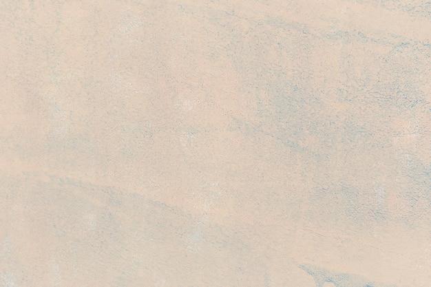 Crème gladde getextureerde muur achtergrond