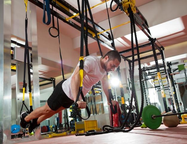 Crossfit fitness trx push-ups man workout