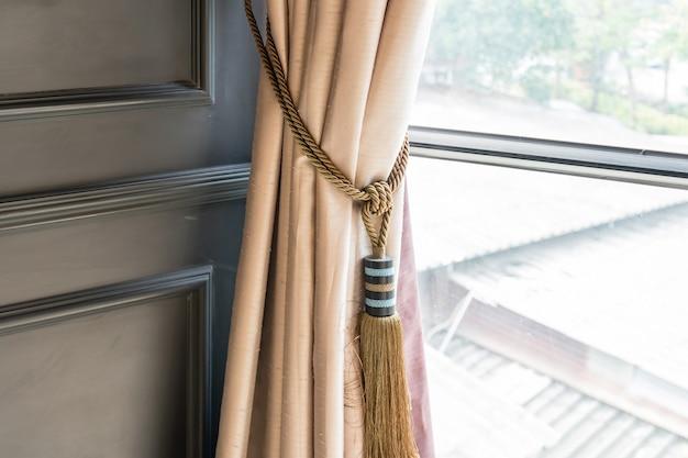 Curtains kwast voor interieur luxe huis onderdeel van prachtig gedrapeerd gordijn