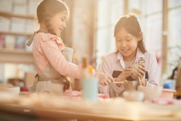 Cute girls in crafting workshop
