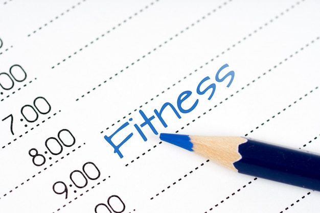 Dagschema fitness met blauw potlood