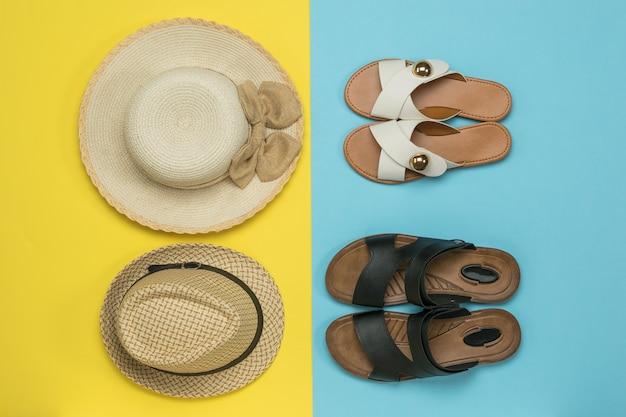 Dames- en herenhoeden en dames- en herensandalen. het concept van een zomervakantie met het gezin.