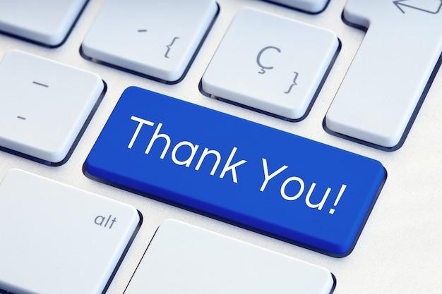 Dank u word op blauwe computer toetsenbordsleutel