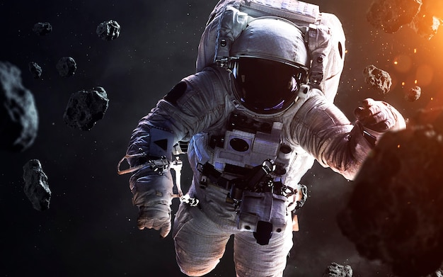 Dappere astronaut op de ruimtewandeling. mensen in de ruimte. elementen van deze afbeelding geleverd door nasa