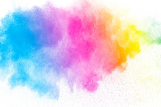 De abstracte explosie van het veelkleurige poeder op witte achtergrond.