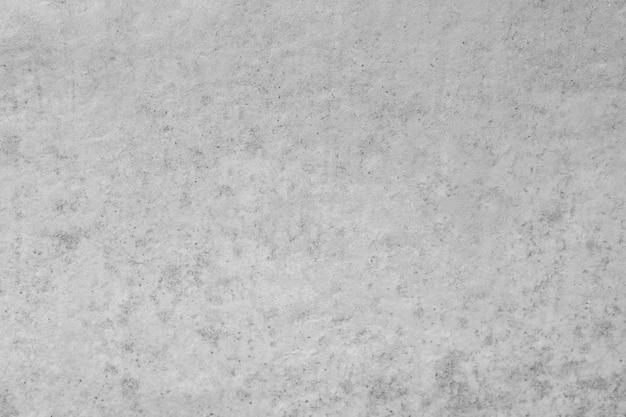 De abstracte grijze concrete achtergrond van de muurtextuur