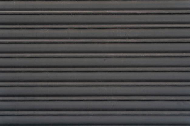 De abstracte horizontale strepen van de staalmuur