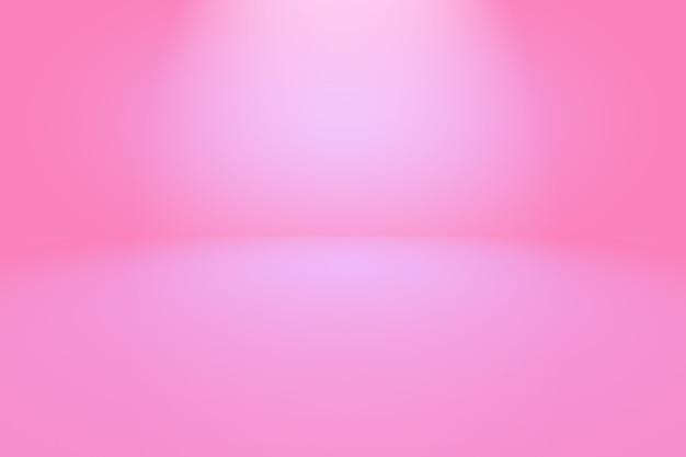 De abstracte lege vlotte lichtroze achtergrond van de studioruimte.