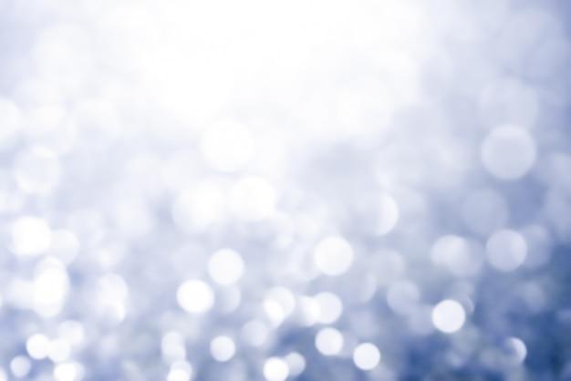 De abstracte lichte schitterende sterren van de kerstmis bokeh textuur op bokeh. glitter vintage lichten