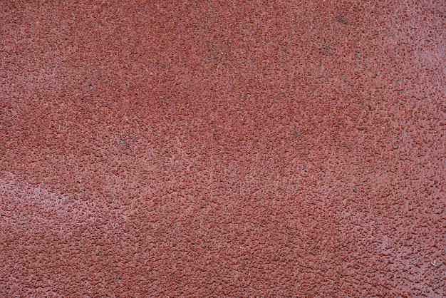 De abstracte rode achtergrond van de granietmuur