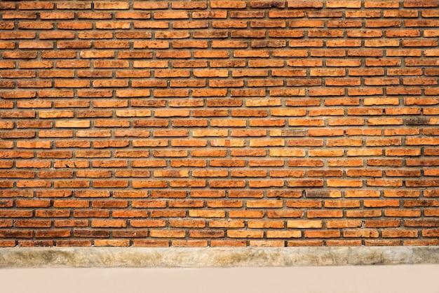 De achtergrond en het oppervlak van de bakstenen muur.