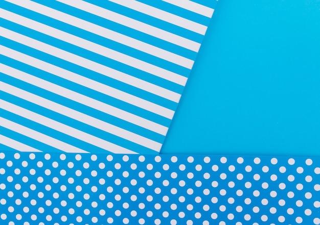 De achtergrond van de textuur van modieuze papieren in de stijl van de geometrie. papier op een blauwe achtergrond. kleur lichte achtergrond.