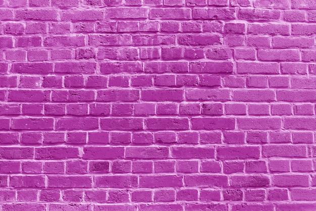 De achtergrond van het oude roze bakstenen muurbehang