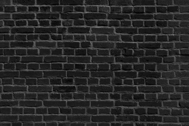 De achtergrond van het oude zwarte bakstenen muurbehang
