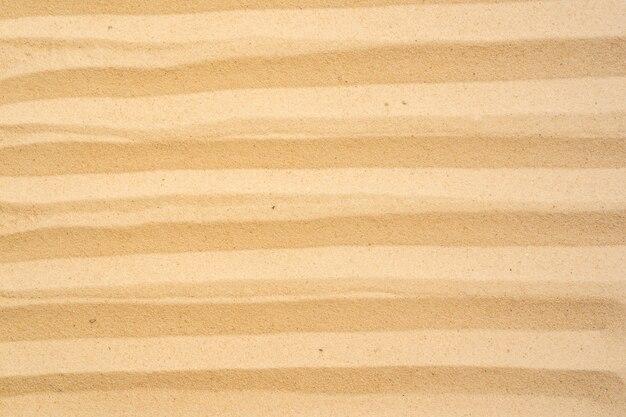 De achtergrond van het zandstrand en textuurpatroon met ruimte.