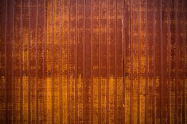 De achtergrond van oud zink en roest op de oude zinkachtergrondmuur de gegolfde metalen wand