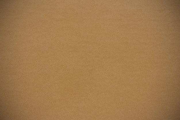 De achtergrondstructuur is gemaakt van het boekomslag beige kleur vignet