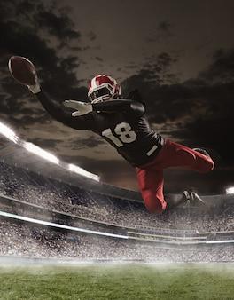 De american football-speler in actie in het stadion