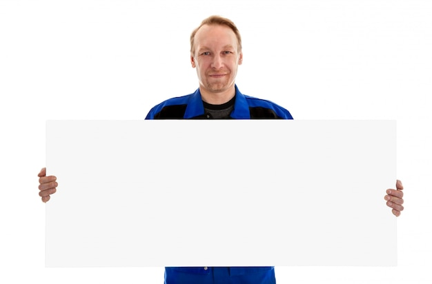 De arbeider in het blauwe eenvormige aanplakbord van het holdings lege teken