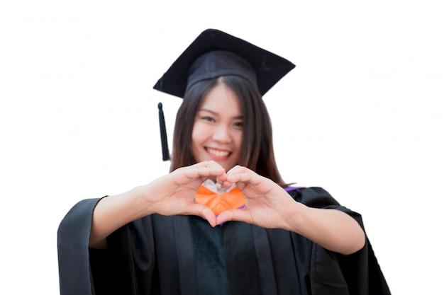 De aziatische leuke graduatie van het vrouwenportret die op wit, de universiteit van thailand wordt geïsoleerd