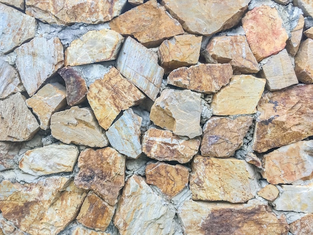 De baksteenpatroon van het close-upoppervlak bij de oude geweven achtergrond van de steenbakstenen muur