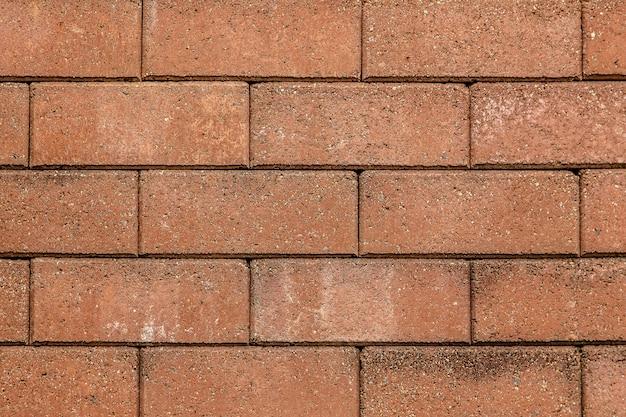 De bakstenen muurpatroon en achtergrond van de zandsteen