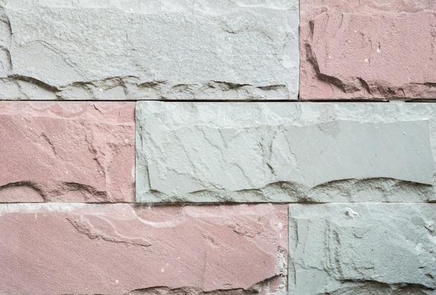 De bakstenen muurtextuur van de close-up oude steen